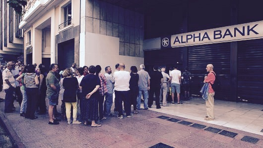 People queuing at at cash strapped banks in Greece